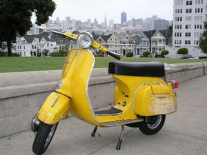 Angela's scooter in scenic Phoenix, Arizona. You can see One Desert Center in the background.