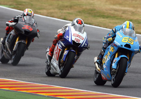 Spaniard Jorge Lorenzo finds himself stuck between a pair of Italians, Marco Melandri (left) and Loris Capirossi.