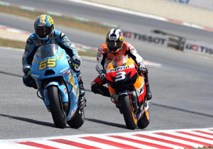 A new engine from Suzuki helped Loris Capirossi out-race Honda's Dani Pedrosa.