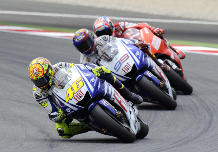 Valentino Rossi, Jorge Lorenzo and Casey Stoner are tied on top of the standings with 106 points and 2 wins apiece.