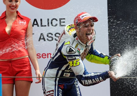 There's something symbolic about spraying champagne bottles around scantily-clad women. Not that we're complaining.