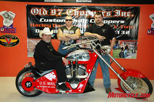 Roger Purgason, aka Rocket Man and Rocket Rogers, sits atop one of his various custom choppers produced at Old 97 Choppers. This bike is the old 97 Chopper.