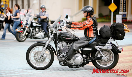 Teresa Weston, one of the winners in the Harley-Davidson women's Get Down to Daytona contest makes her way to the Ocean Center as part of the Women's Day parade.