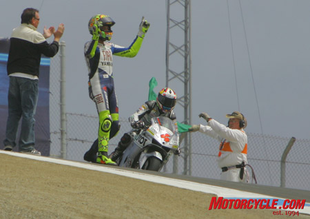 Rossi revels in adulation from the fans in the Corkscrew shortly after kissing that fabled corner.