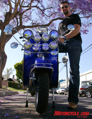 Bartels' 1967 electric-blue Vespa Spring was restored and fitted with, count 'em, 14 lights and 5 mirrors, something you'd see ridden back in the '60s by the Mods who were at odds with the Rockers who rode motorcycles.