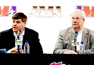 AMA CEO and president Rob Dingman (left) announces the acquisition of the AMA Pro Racing property by the Daytona Motorsports Group (DMG), represented by Roger Edmondson (right).