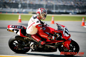 Five-time Daytona 200 winner Miguel Duhamel follows the pace car after switching motorcycles during a yellow flag in the 2008 Formula Xtreme race. He was disqualified 50 laps later after the AMA judged his bike switcheroo to be illegal.