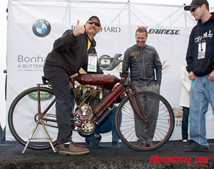 Vince Martinico on the first of his four appearances on the stage. He's just started his 1908 Indian Torpedo Tank Racer as Jeff Decker, who chose this motorcycle for the Sculptor's Award, looks on approvingly.
