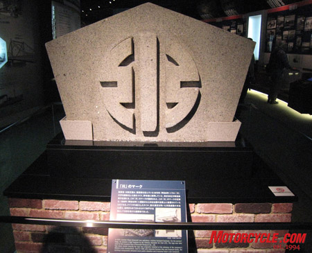 Company founder Shozo Kawasaki created a logo inspired by the Japanese character for river for his marine transport business in 1875. This stone marker bearing the logo was originally installed at the entrance of Kawasaki Dockyard Co.