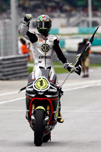 Toni Elias has earned a return ticket to the MotoGP class after winning the Moto2 title.