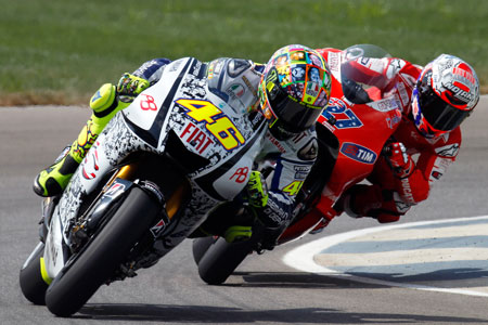 Valentino Rossi and Casey Stoner continue their rivalry in a bid for second overall.