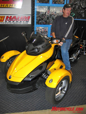 The three-wheeled Can-Am Spyder runs a 106-hp Rotax Twin. Street-legal fun for $18K.