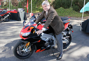 In a lighter moment, Timoni straddled one of his company's hottest products at Aprilia's media open house in Costa Mesa.