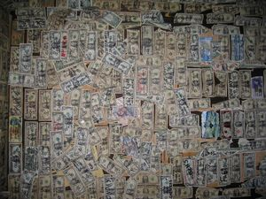 Inside the Oatman Hotel Restaurant. Visitors are encouraged to write their name and home town on a dollar bill, and tack it on the wall. Locals estimate that over 20,000 bills cover the walls and ceiling.