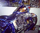 Sporting what must be the ultimate cool paint job is this Hog in the Super Bikes N.V. showroom. Check out all the details. Every James Bond movie ever made has been depicted somewhere on the bike. The complete list of films is the highlight of the gas tank design scheme. Missile launcher costs extra, but it is a guaranteed babe-magnet and turns into a submarine at the touch of a button.