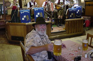 "No trip to Germany would be complete without visiting a few Bier Gartens. Here, I hoist a ""small"" stein in the most famous of them all, the Hofbrau Haus in Munich. This ancient and giant establishment is where Hitler started his National Socialist Party."