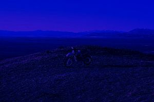 """At night the land and sky blur into a single thing. By day, you ride ON the desert. At night, you ride IN it."""