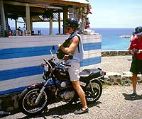 The massive Yamaha 125 was perfect for this drive-thru snack stand. Notice the stylish luggage frontpack we used to carry our stuff. When you're in the islands, there are no worries, even when you look like a dork.