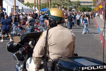 Officer Joe serves and protects at BikeFest while grooving to his unofficial copper iPod.