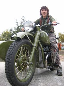 Hot Asian chick on a Russian bike? Sure! she's welcome at any Britbike rally.