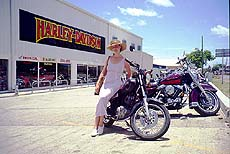 Danielle, sprucing up the parking lot. This dealership was renting out Harley-Davidson bikes for $65/day during the summer off-season. Expect to put up a hefty deposit on your plastic for the honor of riding American.