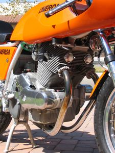 Laverda basically copied the jewel-liked Honda CB77 twin cylinder engine... look at the 750 SFC's engine and you'll see the direct DNA connection.