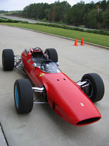 A view of a 1964 Ferrari 158 like that used by World Champion motorcycle roadracer John Surtees to win the 1964 F1 title - becoming the only racer to have won world championships on two wheels and four.