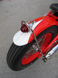 West Eagle fender rib and vintage taillight add nostalgic charm.