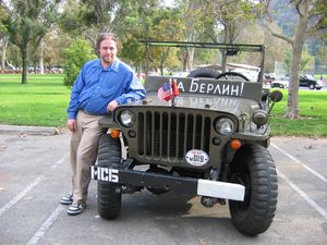 "Two Russians purchased this surplus Jeep and painted ""To Berlin!"" on it in Russian. They parked directly accross from a confused pair of Ural riding Germans."