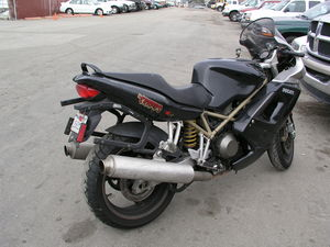 Rick's Ducati ST4 has 50,000 miles without a valve adjustment or belt replacement. It's the special salvage-title maintenance plan.