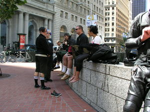 "Messengers hanging out at ""the wall"" in San Francisco's Financial District. Photograph by John Atkins."