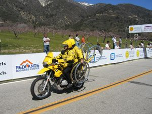 A Team Support motorcycle, carrying spare tires and wheels for the racers.