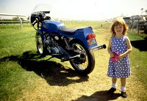 Little Natalie wasn't happy with the stock output of her Commando, next thing we knew, she was blowing-by us at 140, with the front wheel wagging in the air.