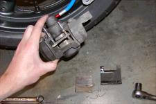 Rear brake pad replacement. Notice the lack of wang hugification.