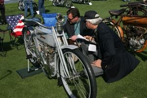 Judges evaluating a 1909 Harley-Davidson 5A