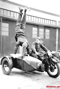 Grandstanding: Most likely a member of the popular German motorcycle stunt teams prior to the war, this soldier does an impromptu handstand on his BMW's sidecar.