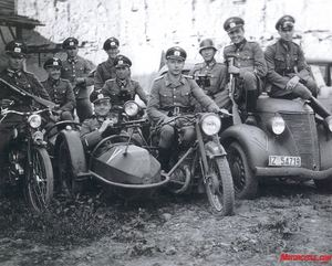 Mechanized Police: A Police Unit poses with their machinegun equipped DKW/sidecar while their comrades carry Schmeisser submachineguns. Similar units of the Police and SS einsatzgruppen took part in the so-called spezial aktions that left mass graves in their wake across Eastern Europe.