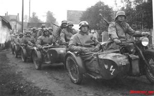 Rifle Corps Convoy: Motorcycle Rifle Troops were established in 1935, designed to transport three fully equipped soldiers into action as quickly as possible. The foreboding line of motorcycle riflemen seen here in their 750cc BMW R12 sidecars stretched far down the road of war, ultimately a literal dead-end for most.
