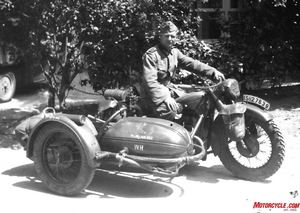 "Tank Buster: With a Steib sidecar modified to carry anti-tank armaments, this soldier had the dubious task of taking on Russian tanks. Note large ""knobby"" front tire and ""blacked out"" headlamp. He wears the Iron Cross First Class which indicates he has performed beyond the call of duty."