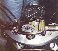 Note the Victory's distinctive handlebar clamp and headlamp-mounted speedo