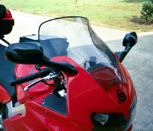 The Givi windscreen raises the airflow about four inches.