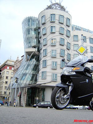 "Frank Gehry's ""Dancing House"" might be wild but is a perfect match to Prague's ornate style. The Teutonic and serious Beemer, on the other hand, wasn't so amused by the sight."