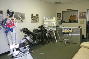 Area P�s waiting room also showcases some old-school racing photos and a set of old-school leathers. The ZX-10R is something Kerry did for fun - it features a full superbike-spec custom exhaust, which he somehow obtained and then modified himself just to see what would happen.