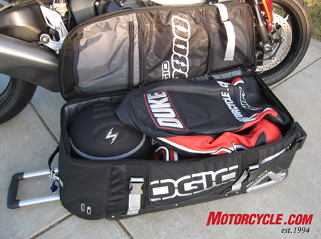 The Zippered Lid Of Ogio 9800 Is Sectioned Into Three Compartments Including A