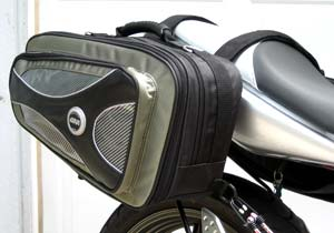 The straps on Givi's saddlebags loop neatly around the seat.