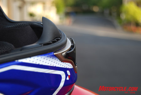 Why the chinbar vent opens outward rather than simply sliding out of the way like the brow vent does, is a mystery on a helmet that has good design everywhere else.