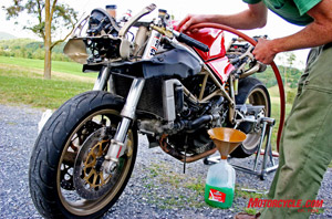 Once you've drained all the anti-freeze from your bike, flush the system with fresh water until you stop seeing green.