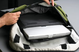 The Timbuk2 Messenger can barely hold the laptop in its sleeve. A purpose built laptop bag is much better.