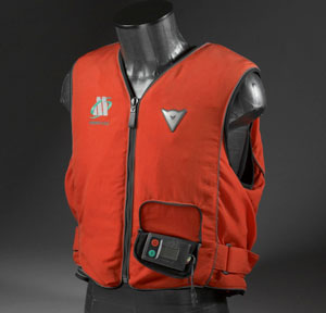 "This is one example of a pre-production street vest. No tethers or dangling cables to trip up in or forget that they're attached. This one's completely wireless, employing complex algorithms to determine when to deploy. Dainese calls it an ""intelligent"" protection system. No production date for street versions yet."
