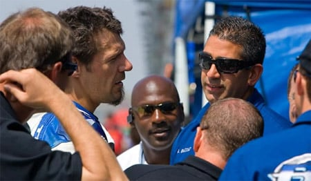 Ammar Bazzaz (right, in sunglasses) confers with Jordan Suzuki Superbike rider Aaron Yates (left) at the racetrack